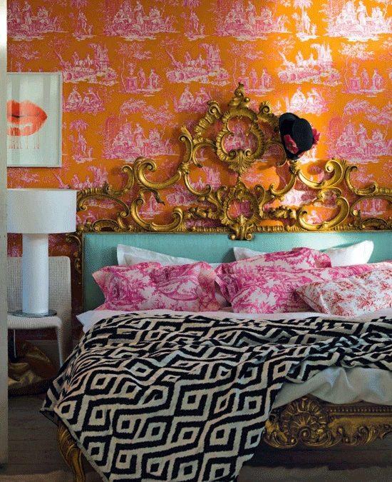 gold headboard + graphic bedspread + toile wallpaper